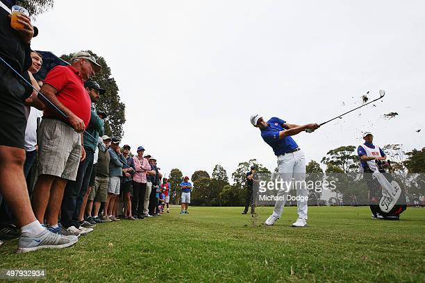 Adam Scott of Australia hits an approach shot during day two of the 2015 Australian Masters at Huntingdale Golf Club on November 20 2015 in Melbourne...