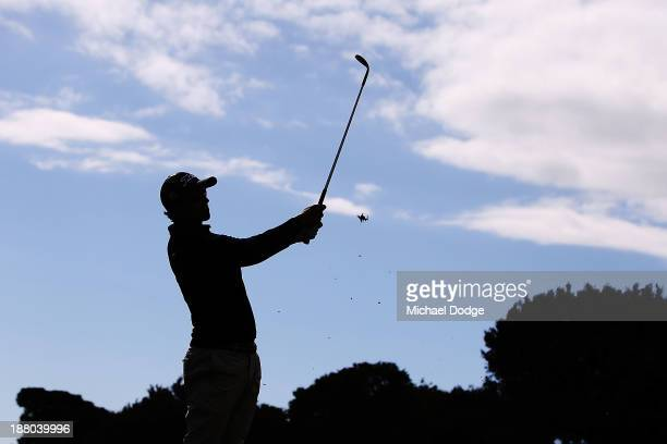 Adam Scott of Australia hits an approach shot during round two of the 2013 Australian Masters at Royal Melbourne Golf Course on November 15, 2013 in...