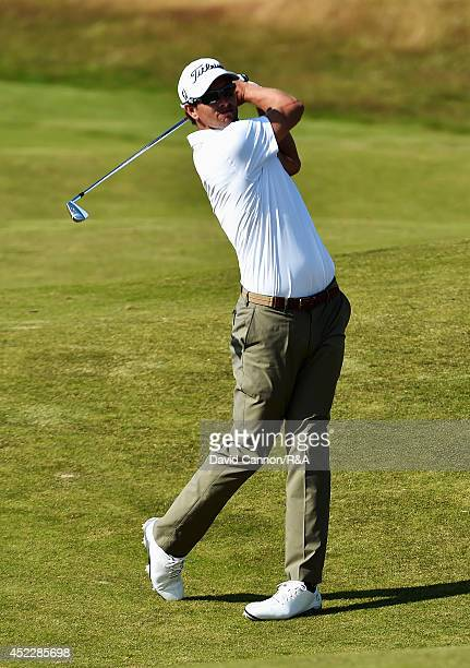 Adam Scott of Australia hits an approach shot during the first round of The 143rd Open Championship at Royal Liverpool on July 17 2014 in Hoylake...