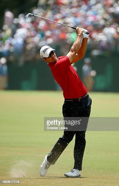 Adam Scott of Australia hits an approach shot on the first hole during the third round of the 114th US Open at Pinehurst Resort Country Club Course...