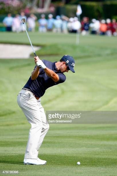 Adam Scott of Australia hits an approach shot on the third hole during the first round of the Arnold Palmer Invitational presented by MasterCard at...