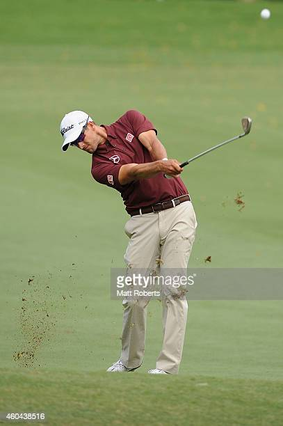 Adam Scott of Australia hits his approach shot on the 17th hole during day four of the 2014 Australian PGA Championship at Royal Pines Resort on...