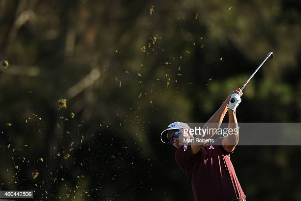 Adam Scott of Australia hits his approach shot on the 18th hole during day four of the 2014 Australian PGA Championship at Royal Pines Resort on...
