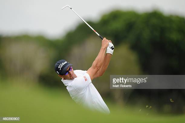 Adam Scott of Australia hits his approach shot on the 7th hole during day three of the 2014 Australian PGA Championship at Royal Pines Resort on...