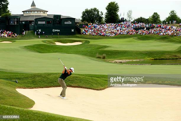 Adam Scott of Australia hits his second shot from a bunker on the 18th hole during the first round of the 96th PGA Championship at Valhalla Golf Club...