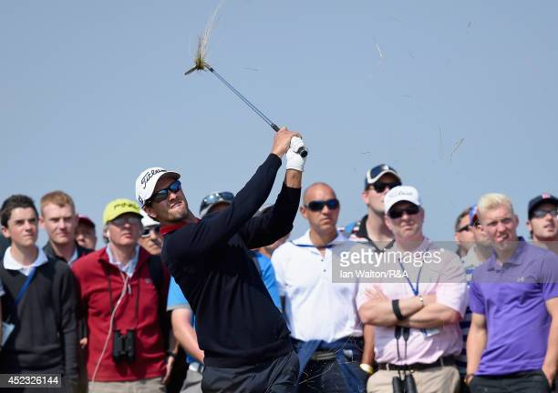 Adam Scott of Australia hits his second shot on the seventh hole as a gallery of fans look on during the second round of The 143rd Open Championship...