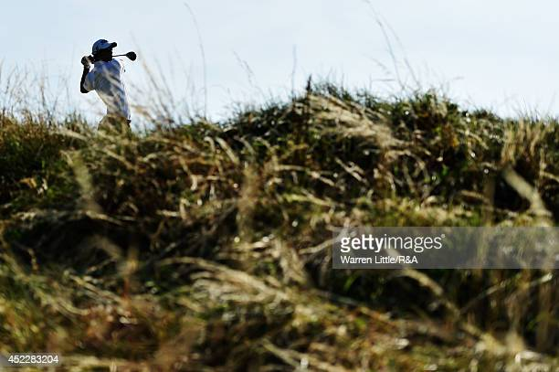 Adam Scott of Australia hits his tee shot on the 12th hole during the first round of The 143rd Open Championship at Royal Liverpool on July 17 2014...