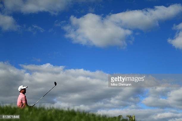 Adam Scott of Australia hits his tee shot on the 13th hole during the final round of the Honda Classic at PGA National Resort Spa Champions Course on...