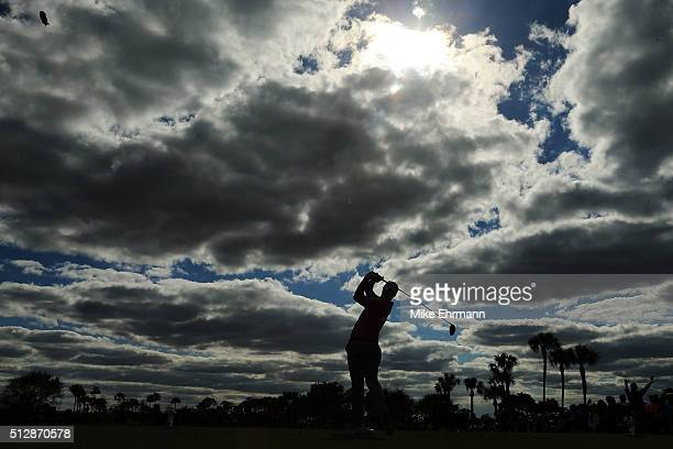 Adam Scott of Australia hits his tee shot on the tenth hole during the final round of the Honda Classic at PGA National Resort Spa Champions Course...