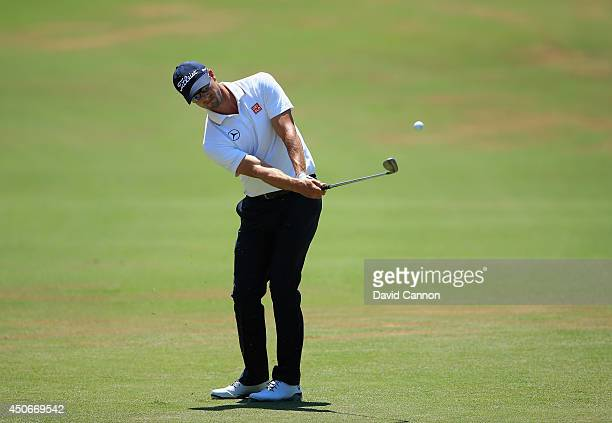Adam Scott of Australia hits his third shot on the fourth hole during the final round of the 114th US Open at Pinehurst Resort Country Club Course No...