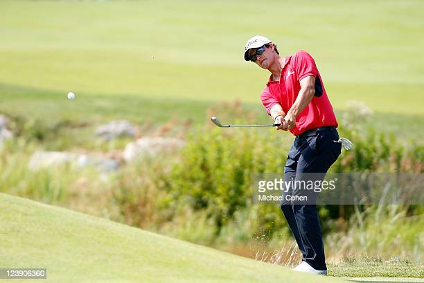 Adam Scott of Australia hits in a chip shot for an eagle on the second hole during the final round of the Deutsche Bank Championship at TPC Boston on...