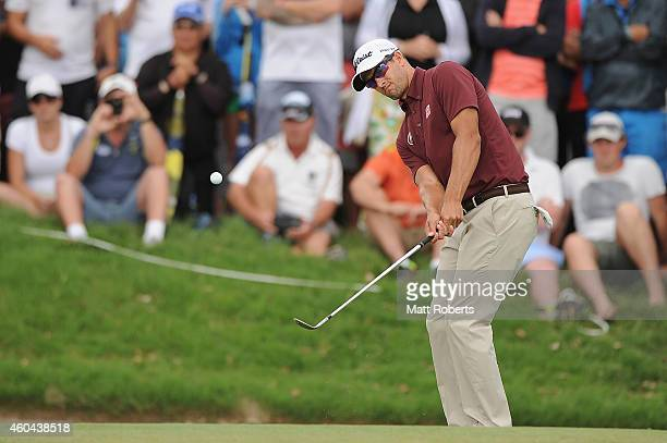 Adam Scott of Australia hits onto the 18th green during day four of the 2014 Australian PGA Championship at Royal Pines Resort on December 14, 2014...