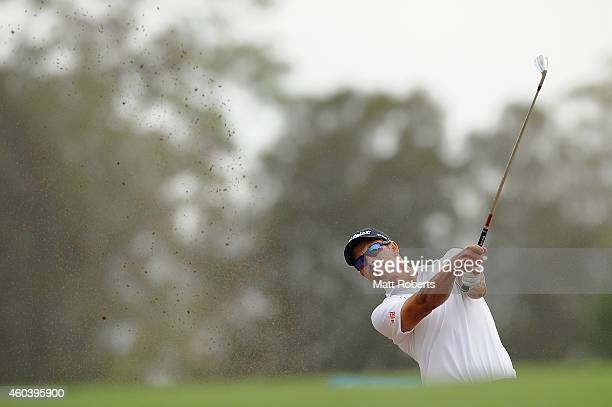 Adam Scott of Australia hits out of the bunker on the 18th hole during day three of the 2014 Australian PGA Championship at Royal Pines Resort on...