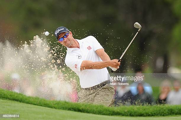 Adam Scott of Australia hits out of the bunker on the 3rd hole during day three of the 2014 Australian PGA Championship at Royal Pines Resort on...