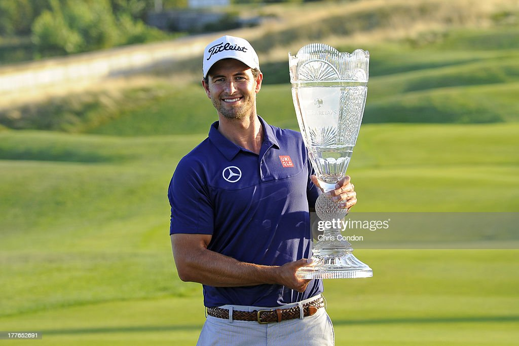 Adam Scott of Australia holds the tournament trophy after winning The Barclays at Liberty National Golf Club on August 25, 2013 in Jersey City, New Jersey.