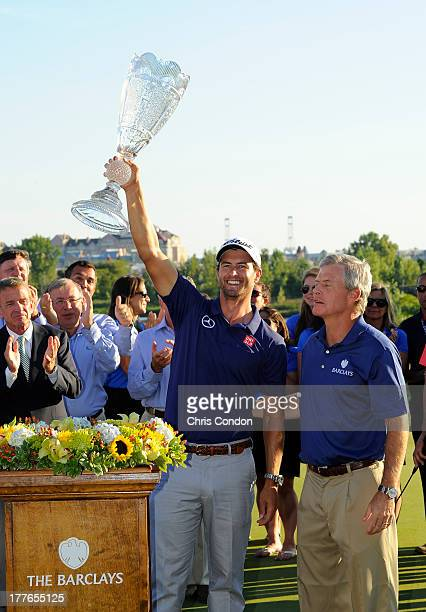 Adam Scott of Australia holds the tournament trophy after winning The Barclays at Liberty National Golf Club on August 25 2013 in Jersey City New...