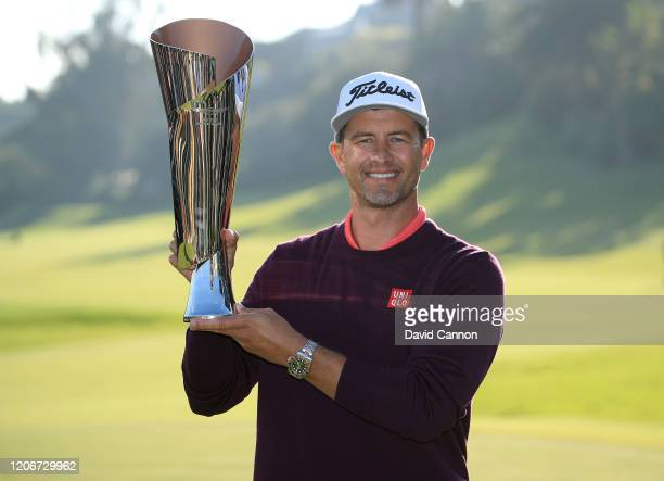 Adam Scott of Australia holds the trophy after his two shot win during the final round of the Genesis Invitational at The Riviera Country Club on...