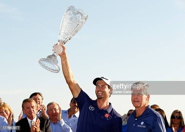 Adam Scott of Australia holds the trophy after winning The Barclays at Liberty National Golf Club on August 25 2013 in Jersey City New Jersey