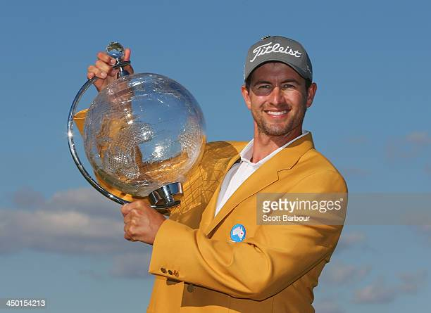 Adam Scott of Australia holds the trophy aloft after winning the tournament during round four of the 2013 Australian Masters at Royal Melbourne Golf...