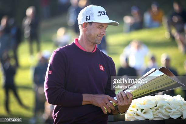 Adam Scott of Australia holds the trophy following the final round of the Genesis Invitational at the Riviera Country Club on February 16 2020 in...