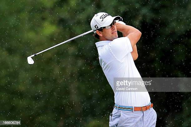 Adam Scott of Australia htis his second shot on the fifth hole during the final round of the 2013 Masters Tournament at Augusta National Golf Club on...
