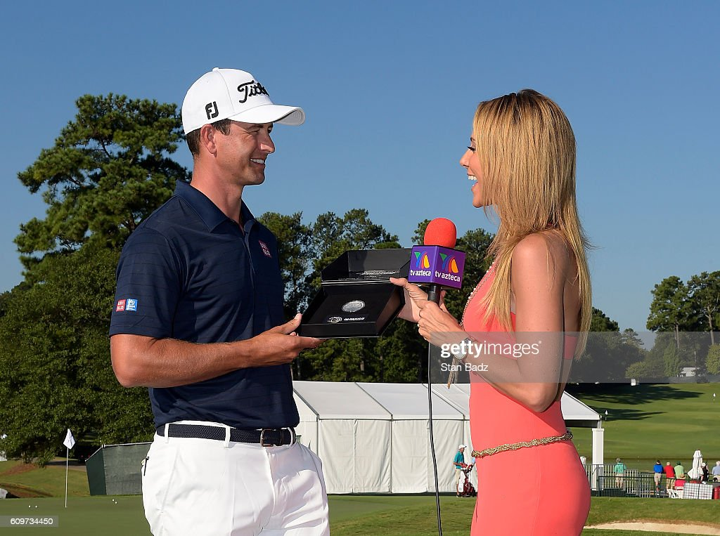 Adam Scott of Australia is presented a WGC Mexico Championship silver coin from Ines Soinz during practice for the TOUR Championship, the final event of the FedExCup Playoffs, at East Lake Golf Club on September 20, 2016 in Atlanta, Georgia.