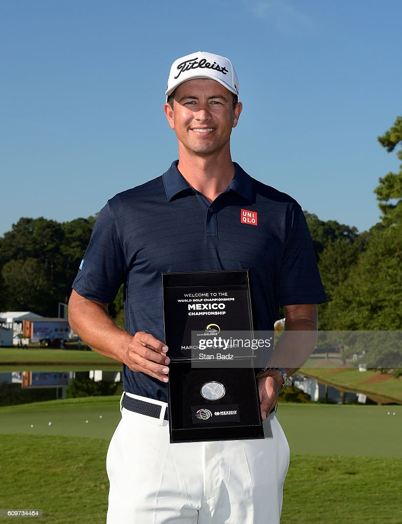 Adam Scott of Australia is presented a WGC Mexico Championship silver coin during practice for the TOUR Championship, the final event of the FedExCup Playoffs, at East Lake Golf Club on September 20, 2016 in Atlanta, Georgia.
