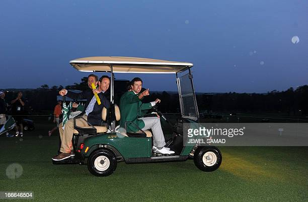 Adam Scott of Australia leaves to give a press conference while wearing his green jacket after winning the 2013 Masters Tournament at Augusta...