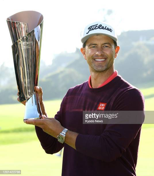 Adam Scott of Australia lifts the trophy after winning the Genesis Invitational at Riviera Country Club in Pacific Palisades California on Feb 16 2020