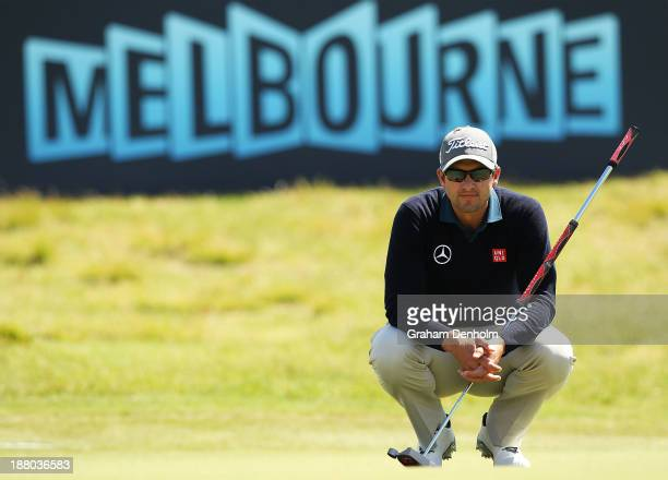 Adam Scott of Australia lines up a putt during round two of the 2013 Australian Masters at Royal Melbourne Golf Course on November 15, 2013 in...