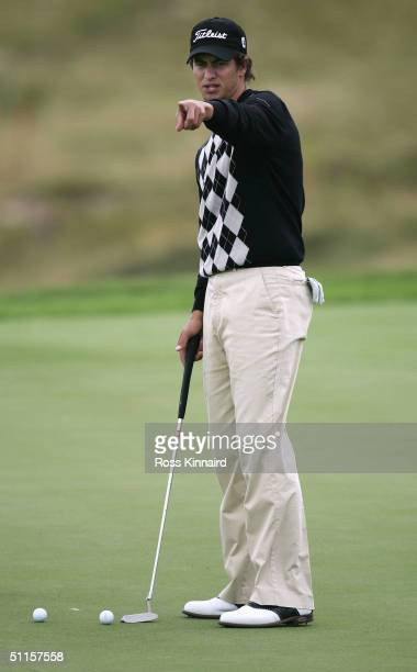Adam Scott of Australia lines up a putt on the 8th green during the practice round of the U.S. PGA Championship at the Whistling Straits Golf Course...