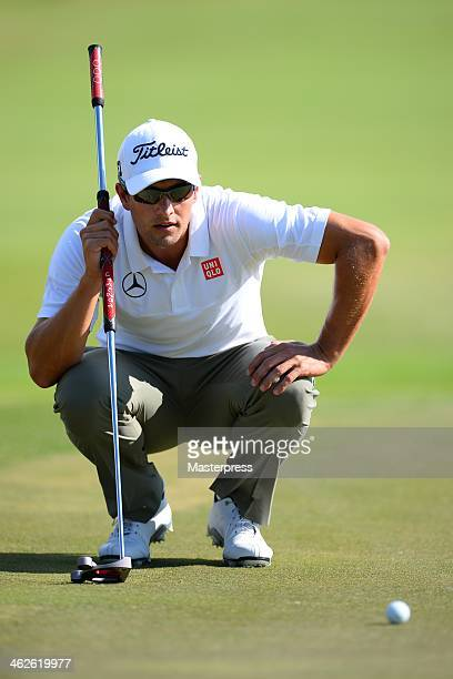 Adam Scott of Australia lines up for a putt on the 3rd green during round three of the Sony Open in Hawaii at Waialae Country Club on January 11 2014...