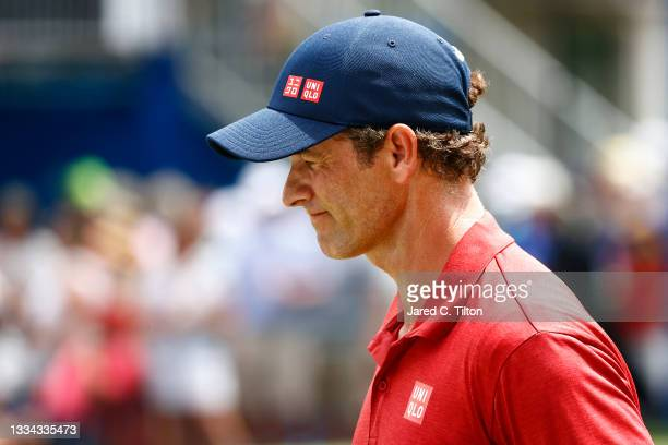 Adam Scott of Australia looks on from the 18th green during the final round of the Wyndham Championship at Sedgefield Country Club on August 15, 2021...