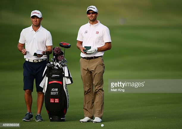 Adam Scott of Australia looks on with his caddie ahead of the 2014 Australia Open at The Australian Golf Course on November 26 2014 in Sydney...