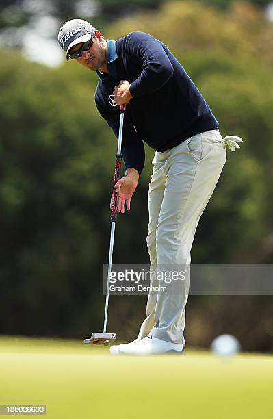 Adam Scott of Australia makes a putt during round two of the 2013 Australian Masters at Royal Melbourne Golf Course on November 15, 2013 in...