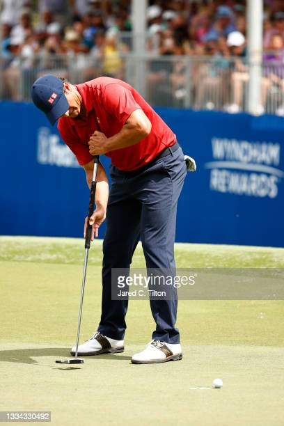 Adam Scott of Australia misses a putt for birdie on the 18th green, the first-playoff hole in a six-way sudden-death playoff, during the final round...