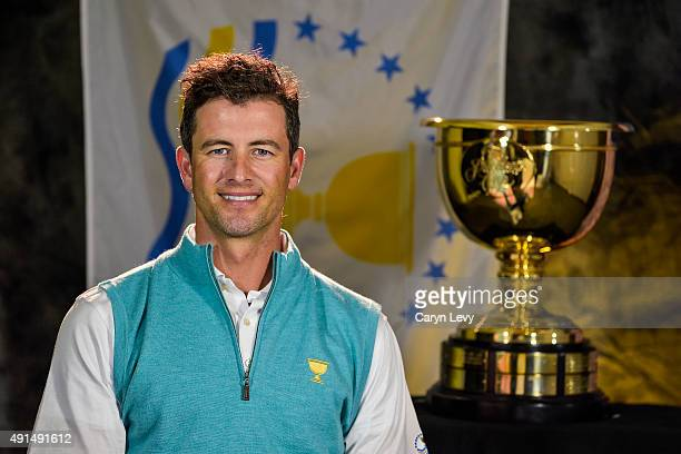 Adam Scott of Australia on the International Team poses for his headshot with the Presidents Cup trophy at the Oakwood Premier Incheon the official...