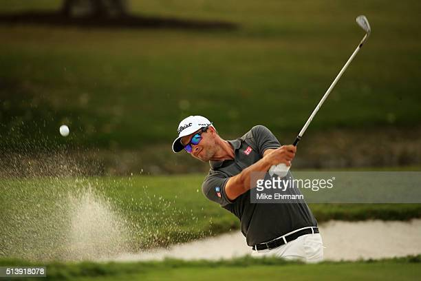 Adam Scott of Australia out of the bunker on the 17th hole during the third round of the World Golf ChampionshipsCadillac Championship at Trump...