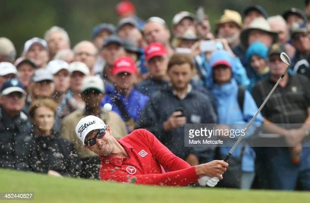 Adam Scott of Australia plays a bunker shot during day two of the Australian Open at Royal Sydney Golf Club on November 29, 2013 in Sydney, Australia.