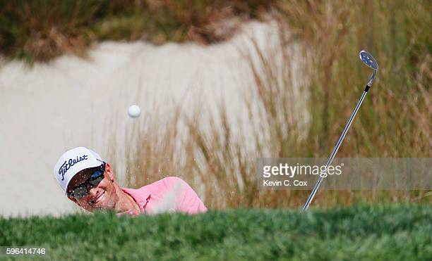 Adam Scott of Australia plays a bunker shot on the 16th hole during the third round of The Barclays in the PGA Tour FedExCup PlayOffs on the Black...