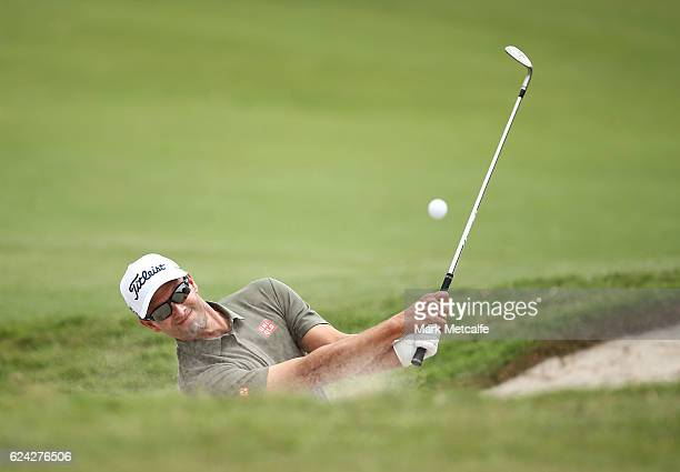 Adam Scott of Australia plays a bunker shot on the 1st hole during day three of the Australian golf Open at Royal Sydney GC at Royal Sydney Golf Club...