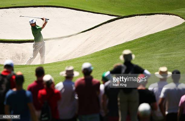 Adam Scott of Australia plays a bunker shot on the 6th hole during day three of the Australian Open at Royal Sydney Golf Club on November 30 2013 in...
