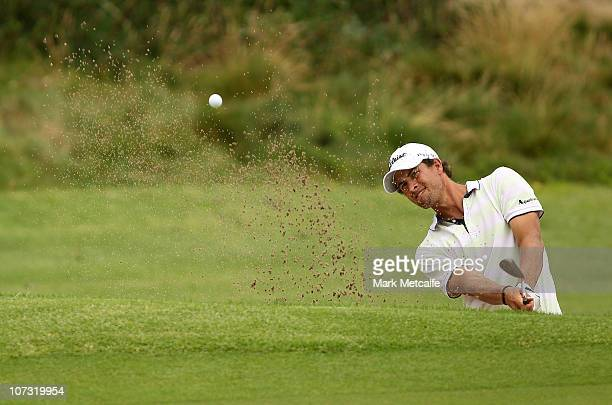 Adam Scott of Australia plays a bunker shot on the 7th hole during day three of the Australian Open at The Lakes Golf Club on December 4 2010 in...