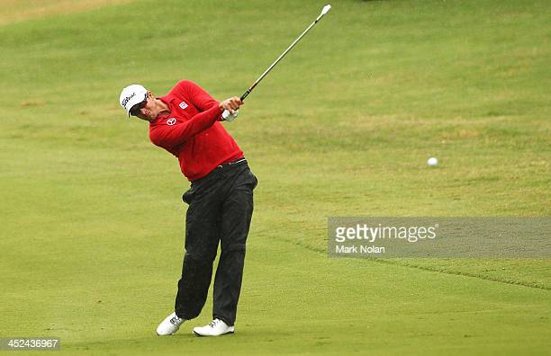Adam Scott of Australia plays a fairway shot during day two of the Australian Open at Royal Sydney Golf Club on November 29, 2013 in Sydney,...