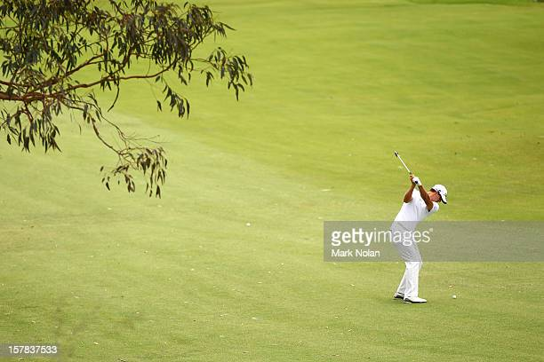 Adam Scott of Australia plays a fairway shot during round two of the 2012 Australian Open at The Lakes Golf Club on December 7 2012 in Sydney...