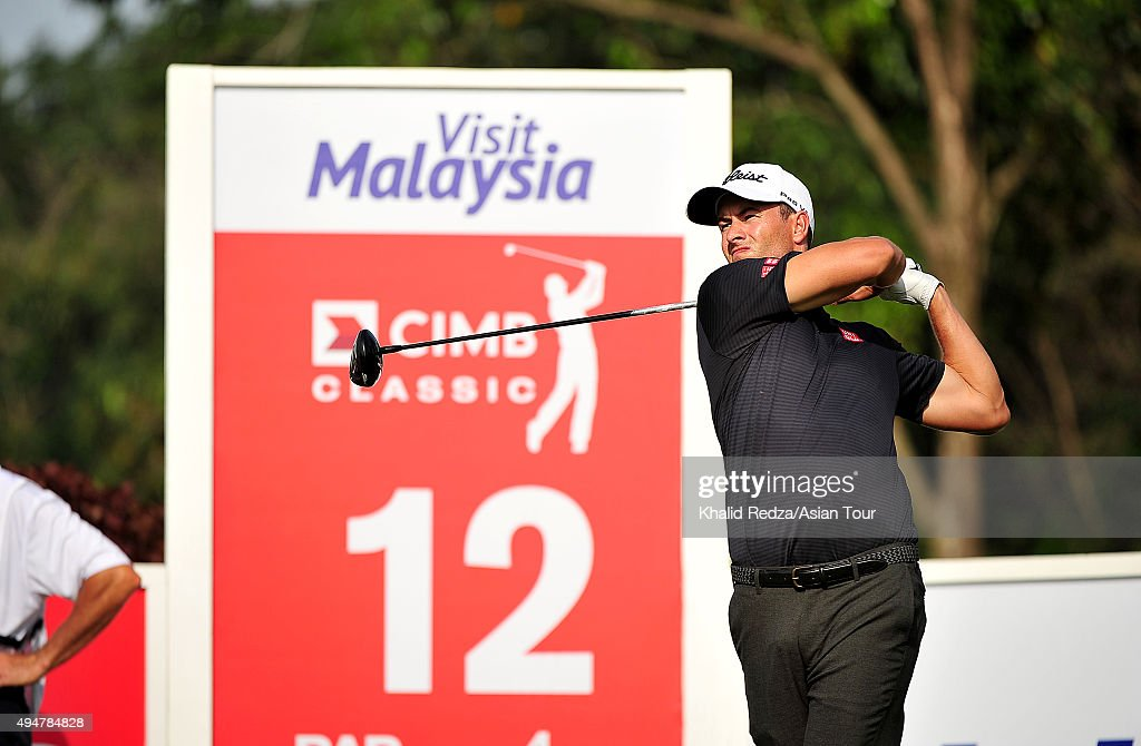 Adam Scott of Australia plays a shot during round one of the CIMB Classic at Kuala Lumpur Golf & Country Club on October 29, 2015 in Kuala Lumpur, Malaysia.