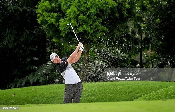 Adam Scott of Australia plays a shot during round three of the CIMB Classic at Kuala Lumpur Golf & Country Club on October 31, 2015 in Kuala Lumpur,...