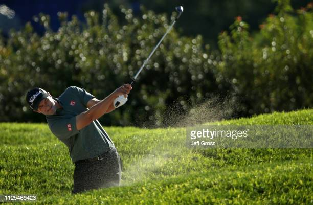 Adam Scott of Australia plays a shot from a bunker on the 14th hole on the South Course during the final round of the the 2019 Farmers Insurance Open...