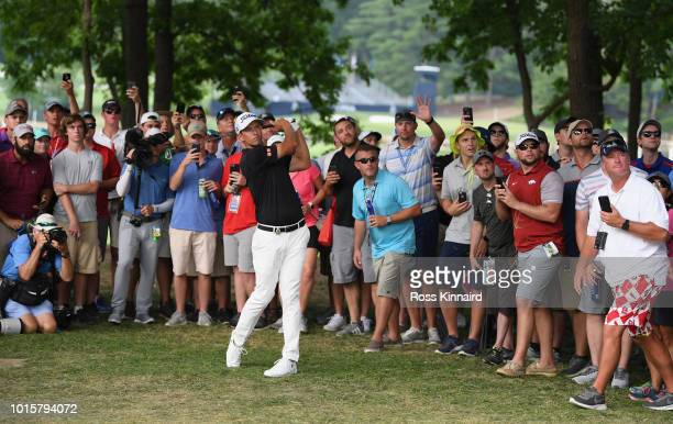Adam Scott of Australia plays a shot on the 15th hole during the final round of the 2018 PGA Championship at Bellerive Country Club on August 12 2018...