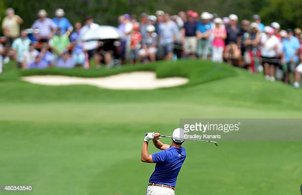 Adam Scott of Australia plays a shot on the 8th hole during day two of the 2014 Australian PGA Championship at Royal Pines Resort on December 12,...